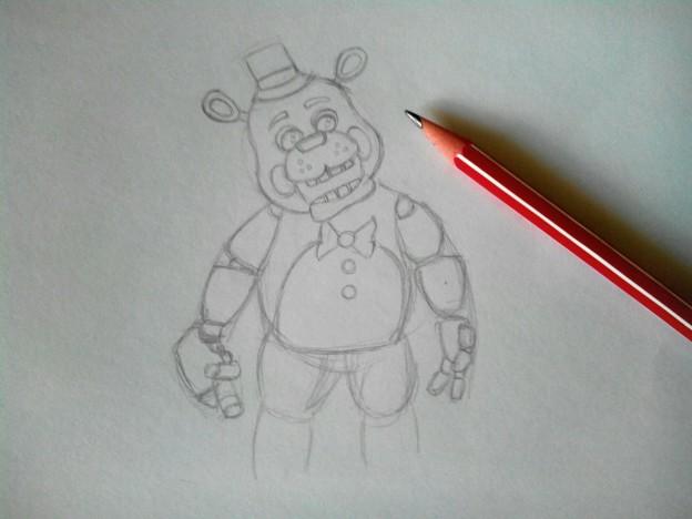 Потом нарисуем ему морду, она не выглядит очень милой, нарисуем обязательно зубы и глаза, уши небольшие и шляпку на голове.